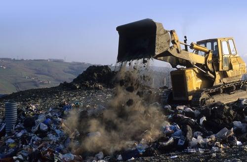 construction vehicle dumping trash